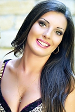 Ukrainian girl Oksana,28 years old with green eyes and dark brown hair.