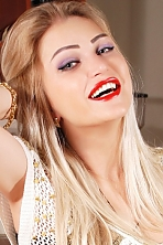 Ukrainian girl Lyudmila,33 years old with grey eyes and blonde hair.