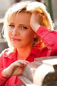 Ukrainian girl Anna,40 years old with grey eyes and blonde hair.