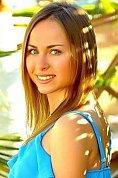 Ukrainian girl Olga,24 years old with blue eyes and black hair.