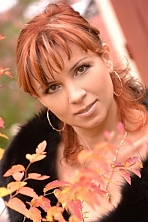 Ukrainian girl Olena,34 years old with brown eyes and light brown hair.