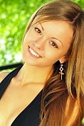 Ukrainian girl Elena,21 years old with brown eyes and light brown hair.
