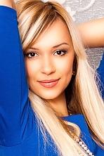 Ukrainian girl Tatiana,32 years old with green eyes and blonde hair.