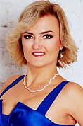 Ukrainian girl Nataliya,38 years old with green eyes and blonde hair.