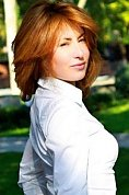 Ukrainian girl Lyudmila,29 years old with blue eyes and red hair.