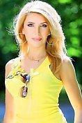 Ukrainian girl Olga,40 years old with brown eyes and dark brown hair.