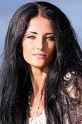 Ukrainian girl Aleksa,33 years old with green eyes and black hair.