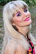 Ukrainian girl Marina,35 years old with green eyes and blonde hair.