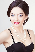 Ukrainian girl Elena,31 years old with blue eyes and black hair.