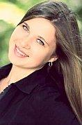 Ukrainian girl Aleksandra,22 years old with blue eyes and dark brown hair.