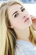 Ukrainian girl Kate,20 years old with green eyes and blonde hair.