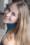 Ukrainian girl Anna,31 years old with grey eyes and light brown hair.