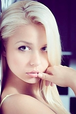 Ukrainian girl Anastasia,22 years old with green eyes and light brown hair.