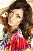Ukrainian girl Olga,22 years old with brown eyes and dark brown hair.