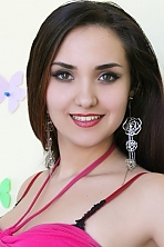 Ukrainian girl Veronika,21 years old with hazel eyes and black hair.