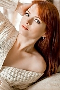 Ukrainian girl Anna,22 years old with blue eyes and red hair.