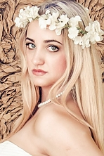 Ukrainian girl Ksenia,23 years old with green eyes and blonde hair.