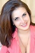 Ukrainian girl Tatiana,31 years old with grey eyes and dark brown hair.