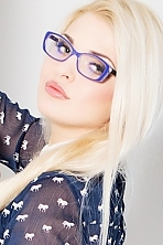 Ukrainian girl Galina,24 years old with grey eyes and blonde hair.