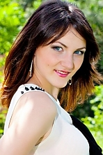 Ukrainian girl Juliya,19 years old with grey eyes and dark brown hair.