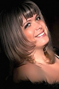 Ukrainian girl Marina,43 years old with green eyes and light brown hair.