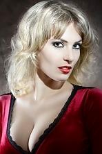 Ukrainian girl Daria,26 years old with grey eyes and blonde hair.