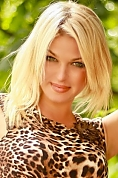 Ukrainian girl Tatyana,34 years old with green eyes and blonde hair.