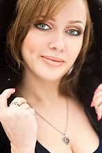 Ukrainian girl Mariya,23 years old with grey eyes and light brown hair.