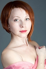 Ukrainian girl Elena,35 years old with green eyes and red hair.