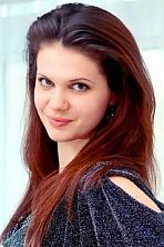 Ukrainian girl Galina,20 years old with green eyes and dark brown hair.
