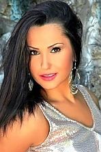 Ukrainian girl Evelina,24 years old with brown eyes and dark brown hair.