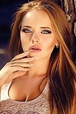 Ukrainian girl Marianna,22 years old with brown eyes and dark brown hair.