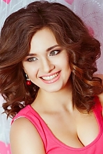 Ukrainian girl Oksana,24 years old with green eyes and light brown hair.