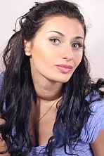Ukrainian girl Maryna,27 years old with green eyes and black hair.