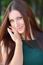 Ukrainian girl Juliya,27 years old with green eyes and dark brown hair.