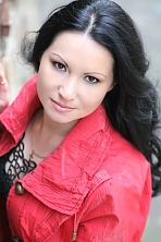 Ukrainian girl Olga,37 years old with brown eyes and black hair.