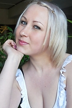 Ukrainian girl Anna ,24 years old with grey eyes and blonde hair.