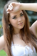 Ukrainian girl Nataliya,21 years old with blue eyes and light brown hair.