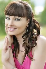 Ukrainian girl Olga,31 years old with brown eyes and dark brown hair.