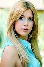 Ukrainian girl Lilia,20 years old with grey eyes and blonde hair.