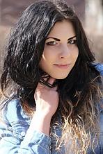 Ukrainian girl Nadya,21 years old with green eyes and black hair.