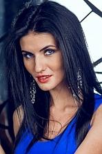 Ukrainian girl Anastasia,25 years old with blue eyes and black hair.