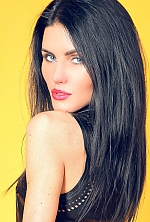 Ukrainian girl Anastasia,25 years old with blue eyes and black hair.