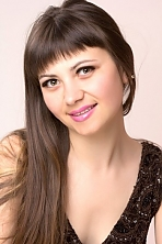 Ukrainian girl Liliya,24 years old with green eyes and dark brown hair.