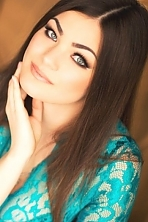 Ukrainian girl Natasha,24 years old with grey eyes and dark brown hair.