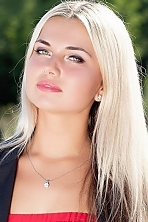 Ukrainian girl Anna,25 years old with green eyes and blonde hair.