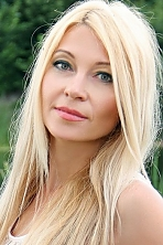 Ukrainian girl Natalia,39 years old with green eyes and blonde hair.