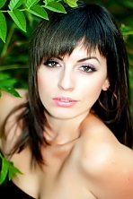 Ukrainian girl Olga,27 years old with hazel eyes and dark brown hair.