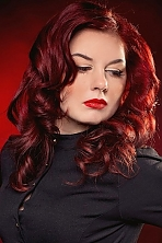 Russian girl Anna,25 years old with green eyes and red hair.