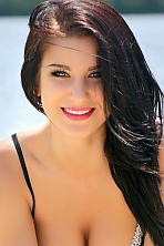 Ukrainian girl Anastasia,20 years old with grey eyes and black hair.
